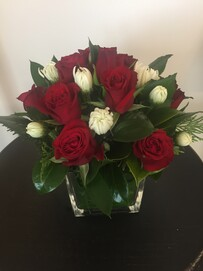 Red Roses in leaf lined cube