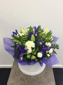 Arrangement in white hat box